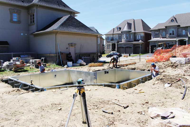 The Pool Craft team installing a small custom backyard swimming pool