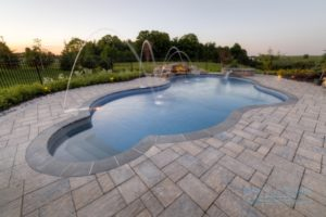 A deck jets water feature installed in a swimming pool