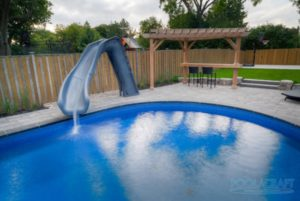 A water slide water features installed in a swimming pool