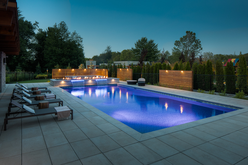 A night time image of a custom saltwater pool