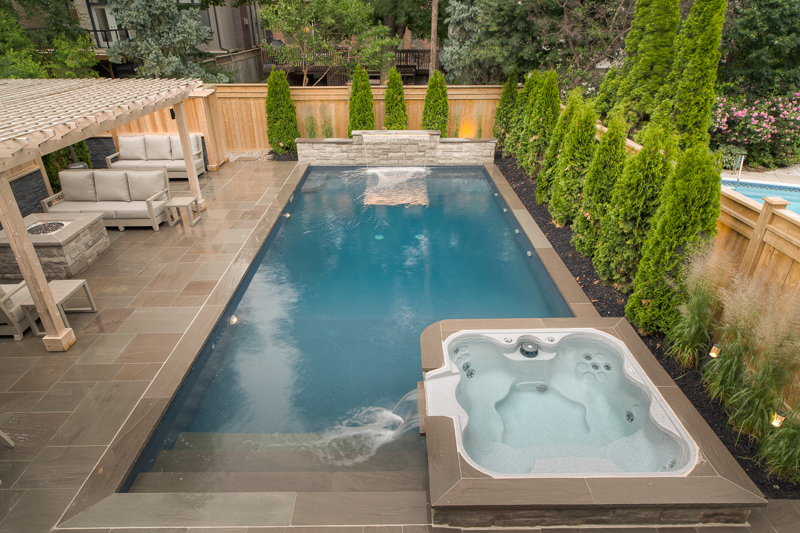A backyard swimming pool with custom landscaping