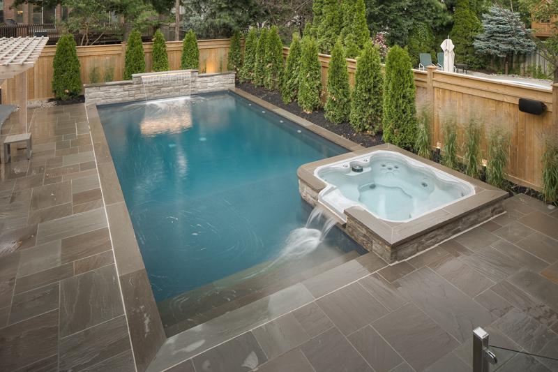 A custom shape backyard swimming pool