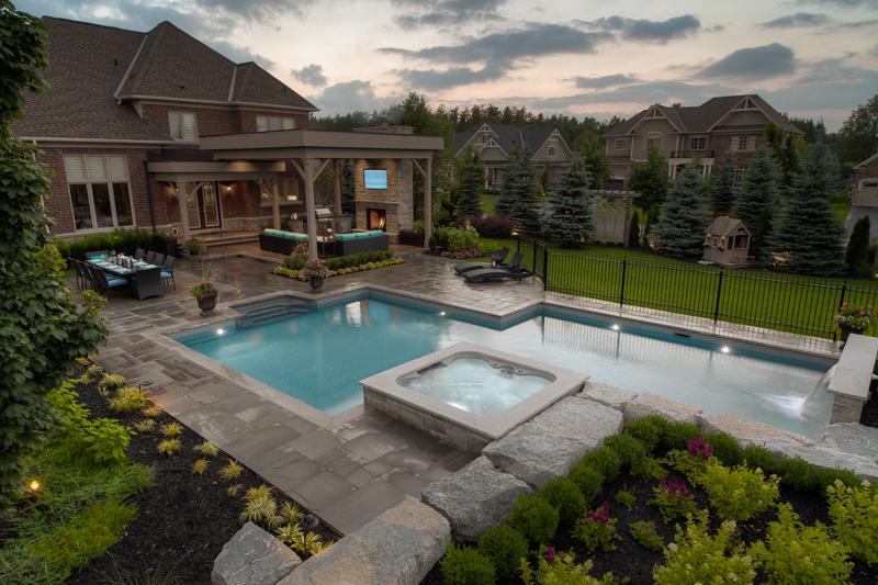 A custom shape backyard pool with spa