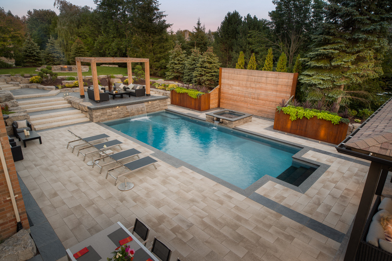 Custom backyard swimming pool designed by Pool Craft