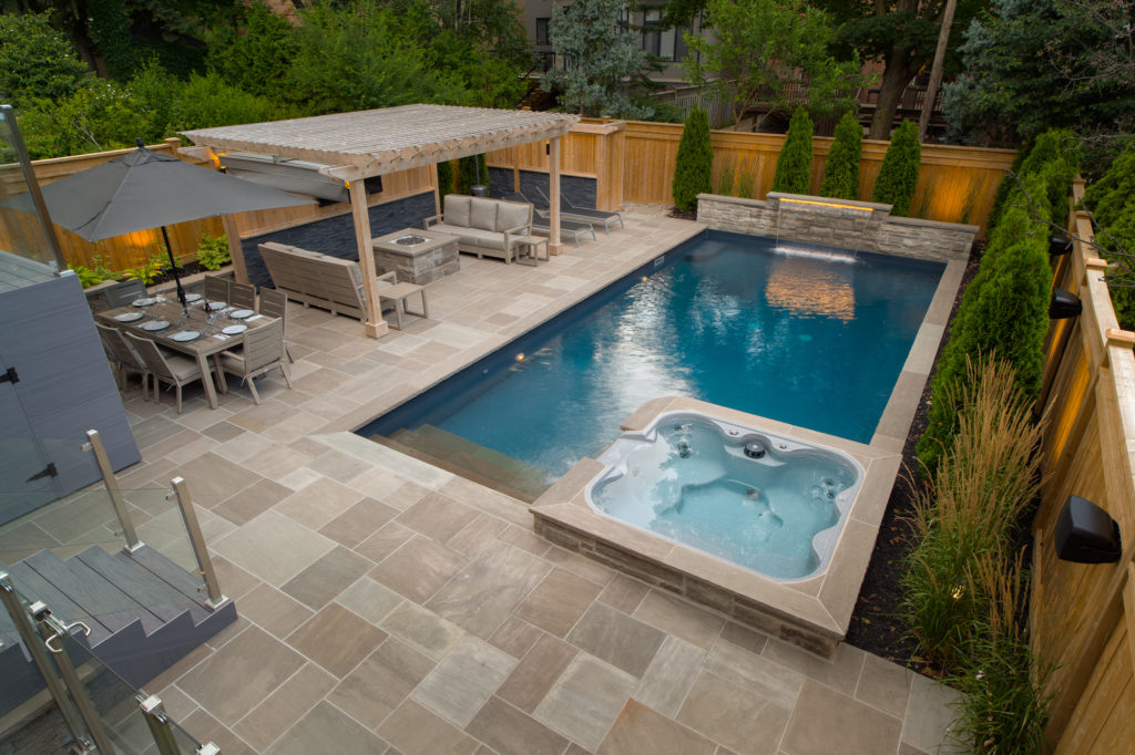 A vinyl swimming pool, designed and installed by Pool Craft
