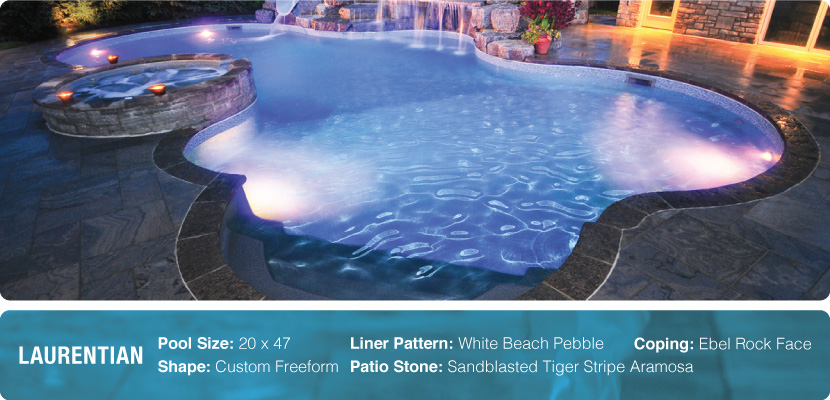 A custom freeform swimming pool with a white beach peddle liner. Custom built and installer by Pool Craft, a pool builder company in Richmond Hill.