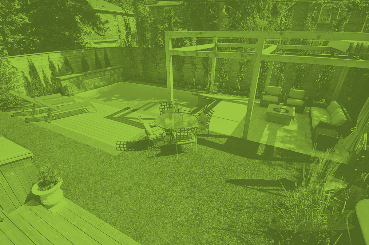 A custom and environmentally conscious backyard with pool and patio, built by Pool Craft