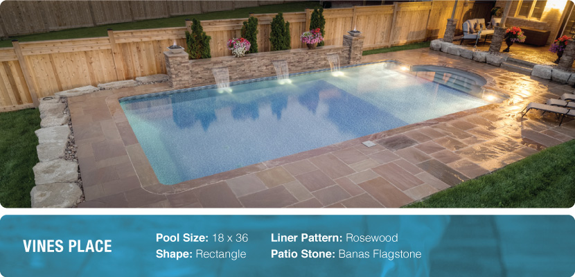A rectangle swimming pool with banas flagstone, designed and built by Richmond Hill's pool company, Pool Craft
