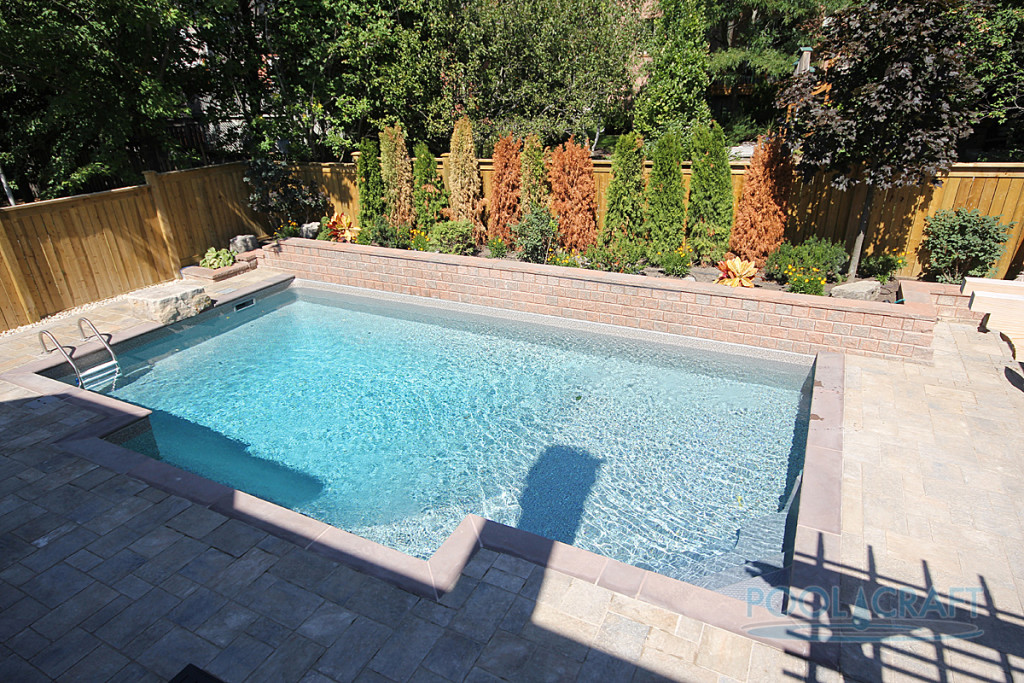 A custom inground pool constructed by Pool Craft for a residential homeowner in Newmarket
