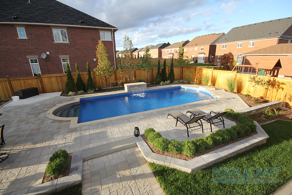 A custom inground pool constructed by Pool Craft for a residential homeowner in Whitby