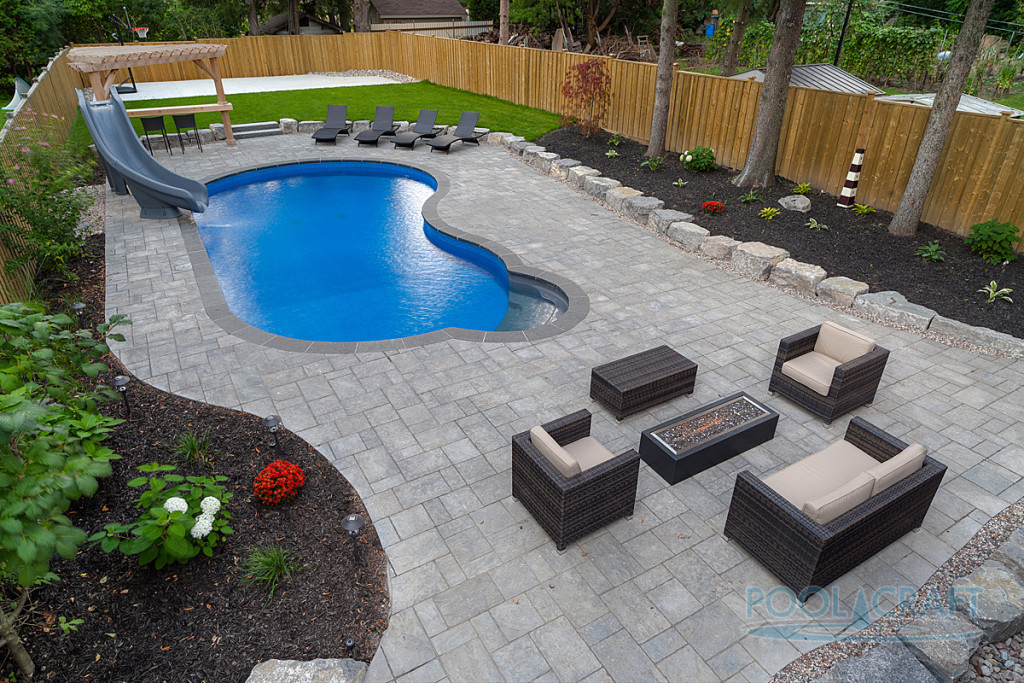 A custom inground pool constructed by Pool Craft for a residential homeowner in Richmond Hill