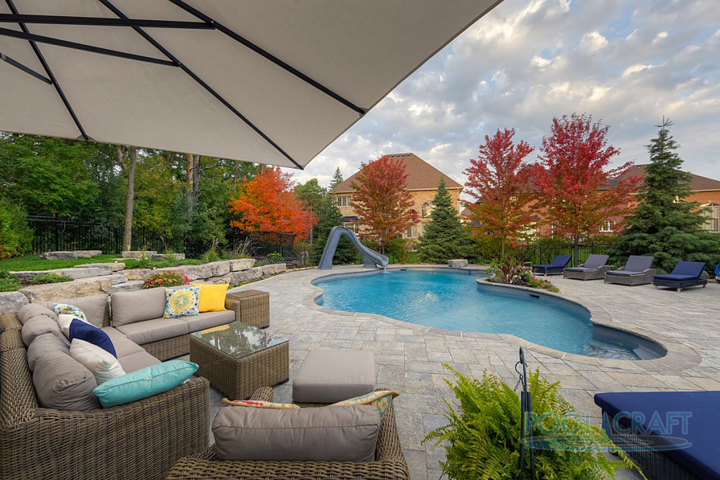 A custom inground pool constructed by Pool Craft for a residential homeowner in Aurora