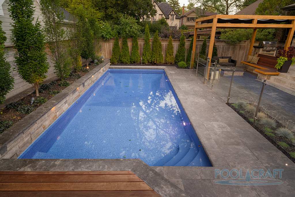 A custom inground pool constructed by Pool Craft for a residential homeowner in Toronto