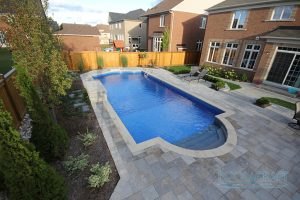 4 Awesome Pools Built in Small Backyards - Pool Craft on stone patios and pools, backyard kitchens and pools, concrete patios and pools, backyard hot tubs and pools, backyard waterfalls and pools, backyard pool houses and pools, backyard arbors and pools, fireplaces and pools, tropical patios and pools,