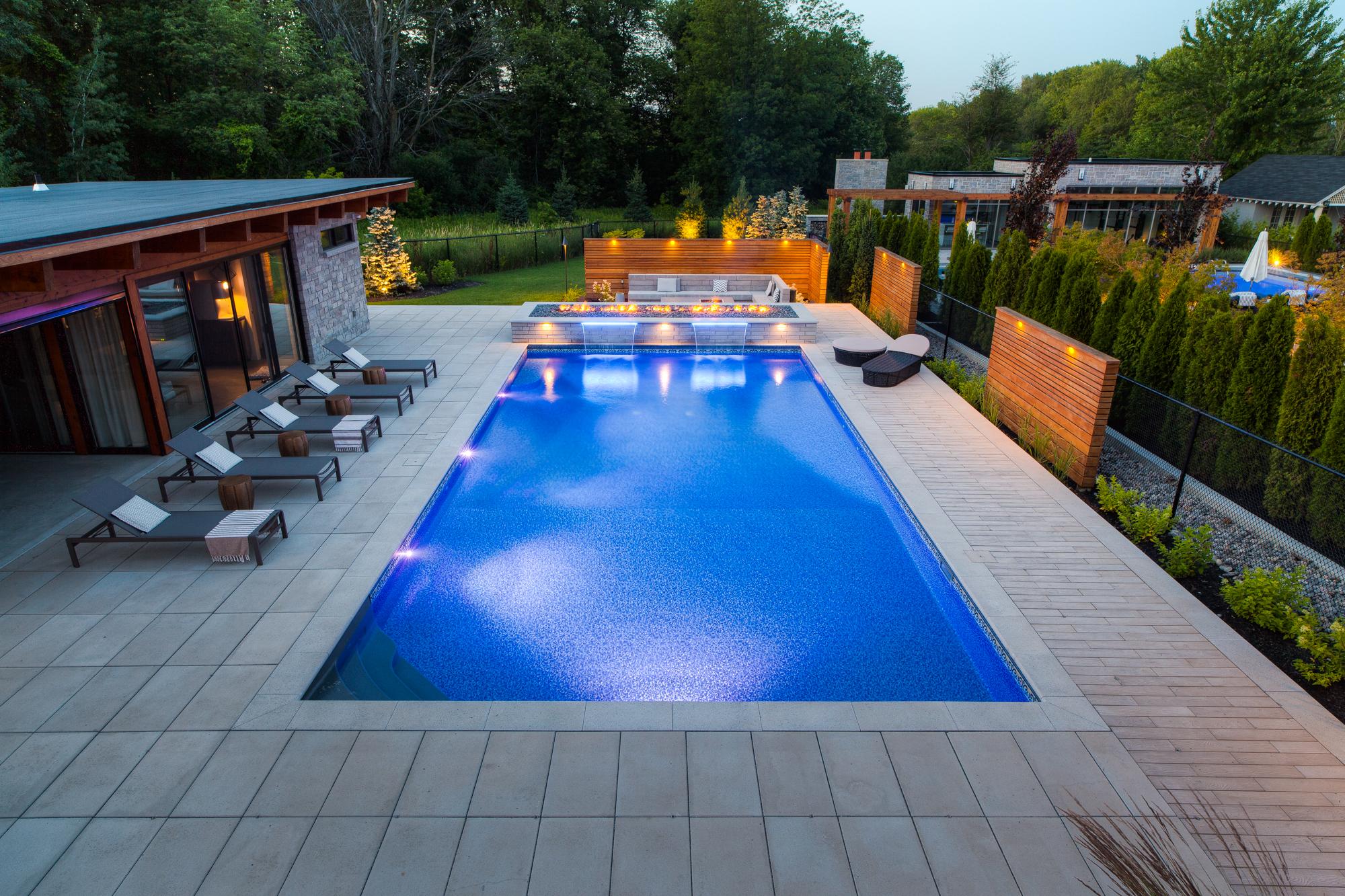 Backyard swimming pool built by a professional pool company