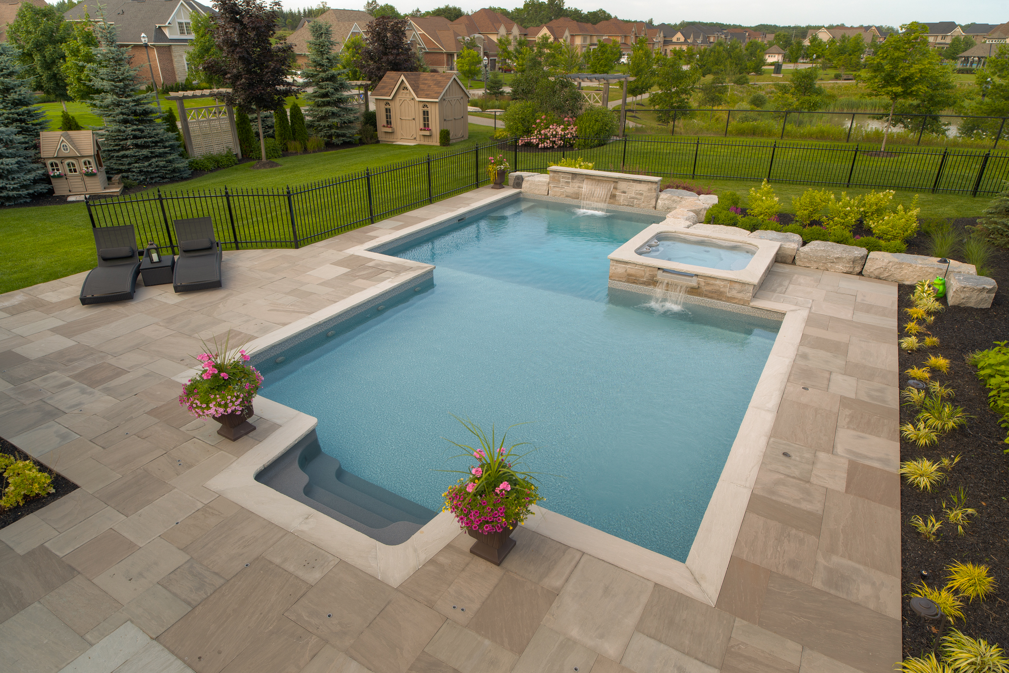 An inground vinyl swimming pool, installed in a residential backyard