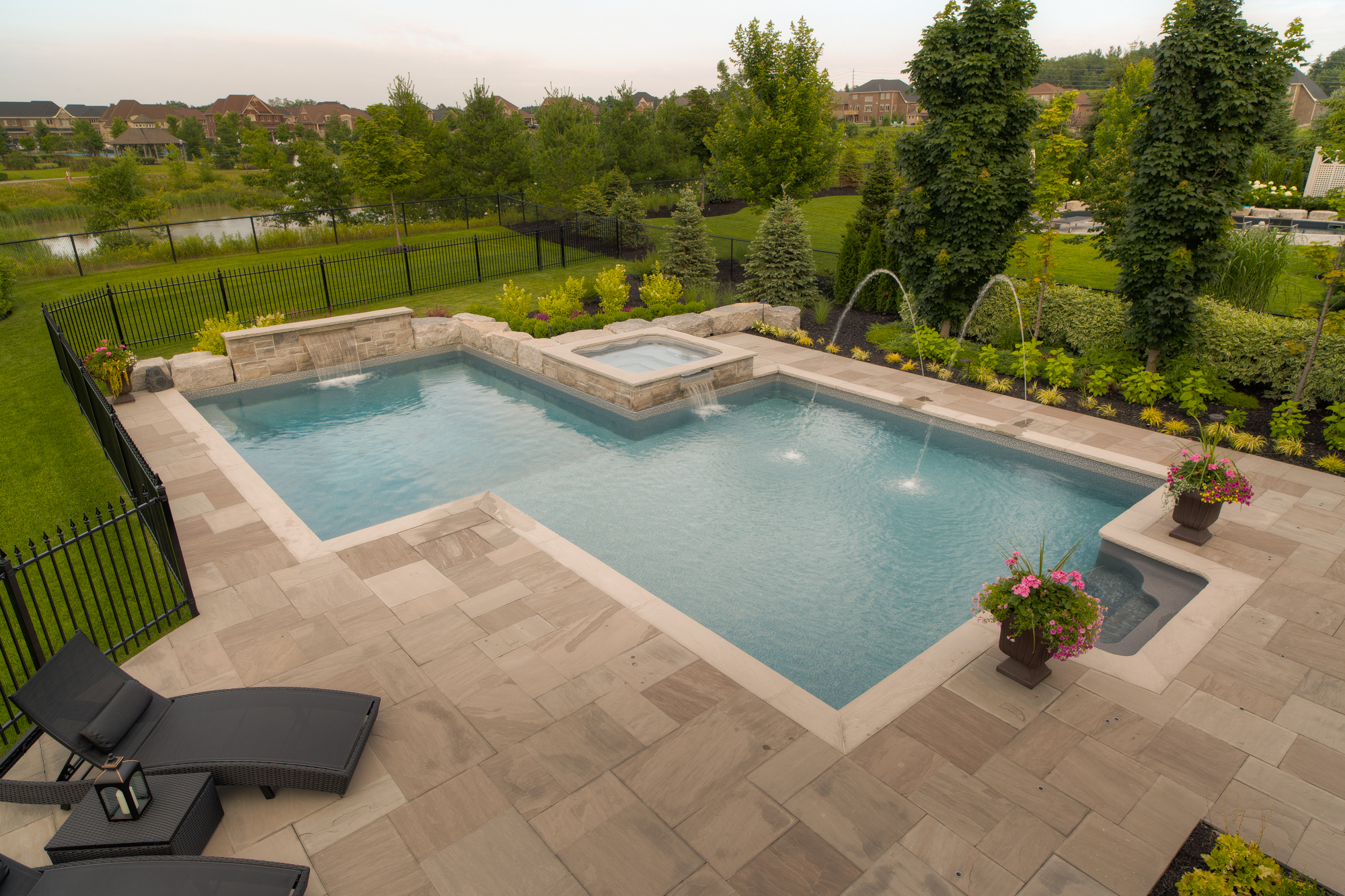A custom swimming pool with deck jets water features