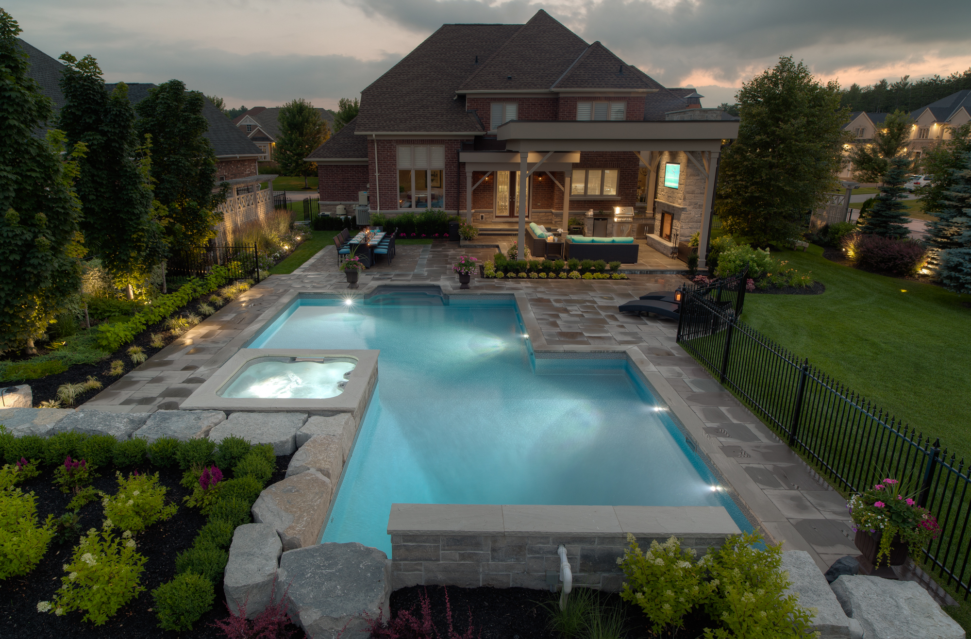 A custom designed and installed backyard swimming pool, built by Pool Craft