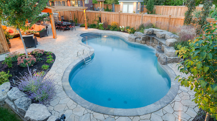 A backyard saltwater swimming pool built by Pool Craft in Richmond Hill