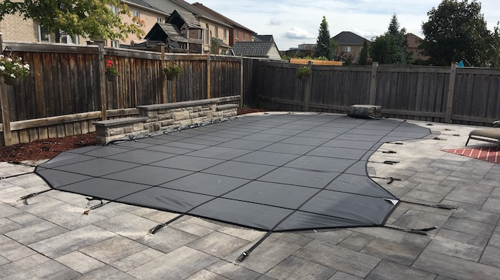 Swimming Pool Safety Cover in Richmond Hill, installed by Pool Craft